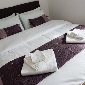 Fresh clean bed linen with towels